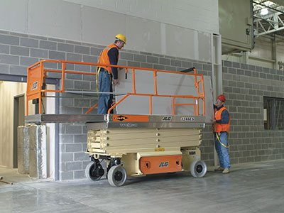 JLG Scissor Lift in Construction Site